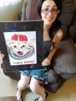 My granddaughter Kate holding a caricature of her cat Scamp. It is also a plug for a business we are about to embark on… hand drawn caricatures of your cats wearing crowns and tiaras . After all they are true royalty. Frank